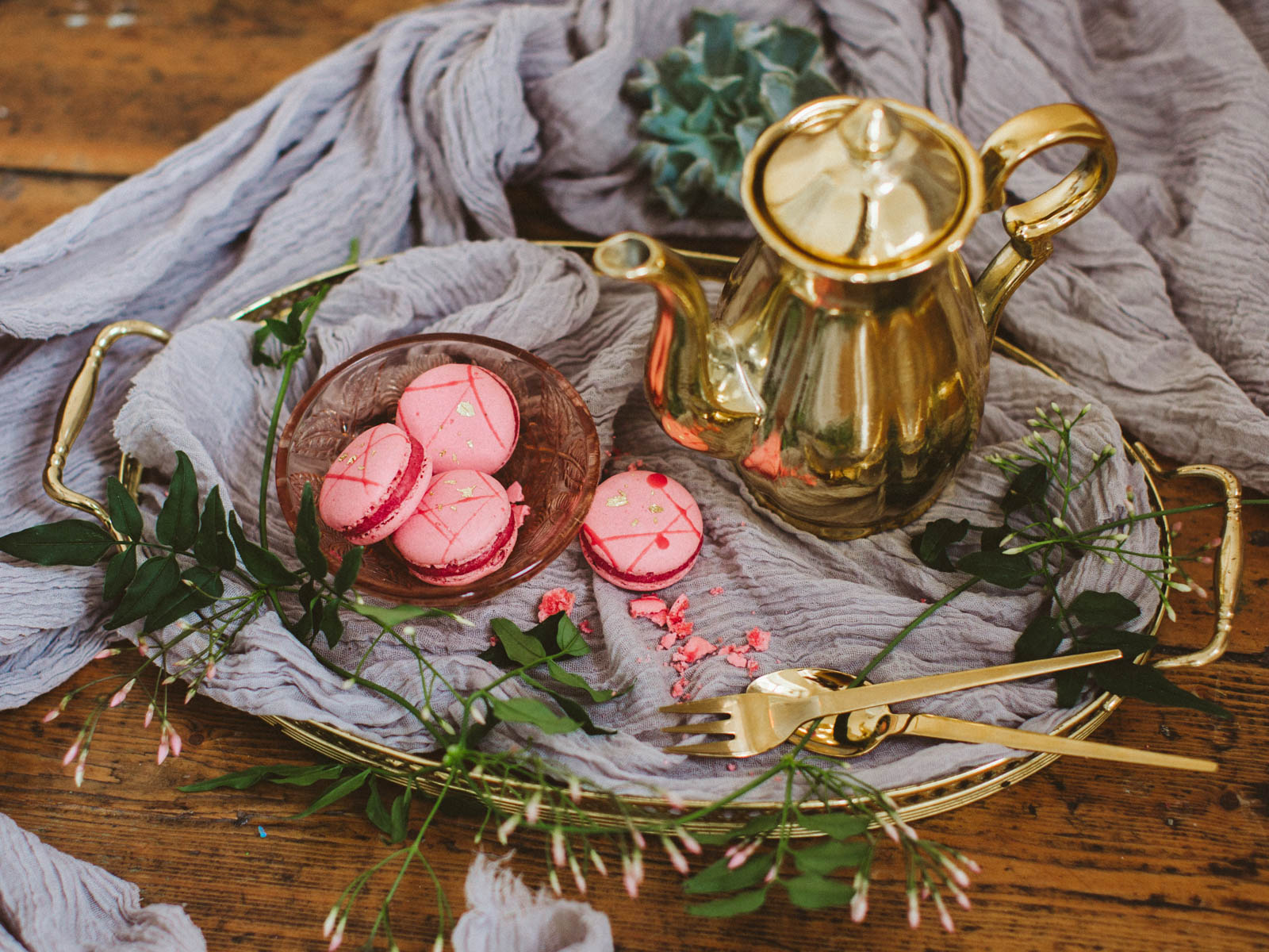 strawberry macarons with gold teapot and cutlery
