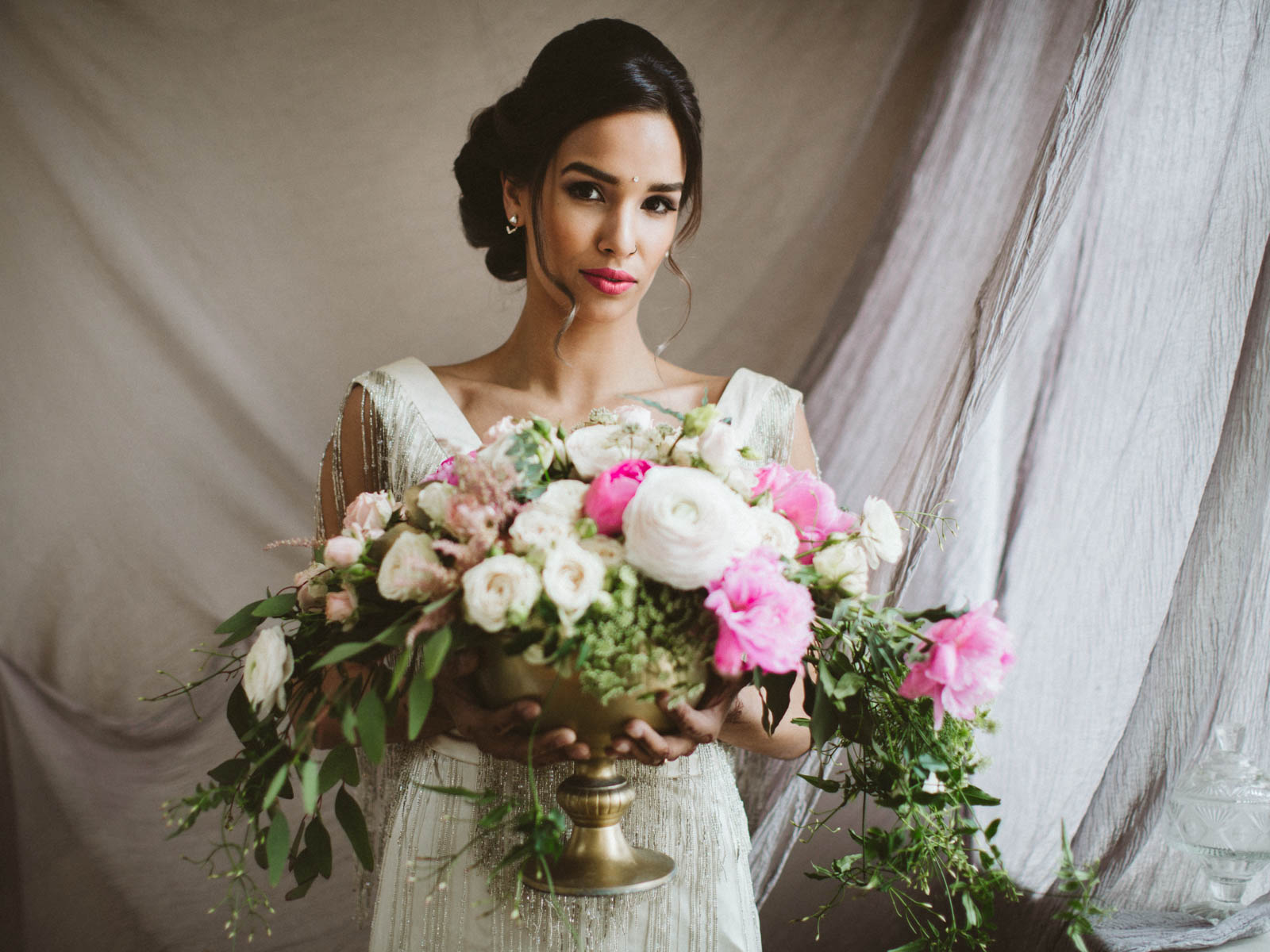indian bride holding bouquet