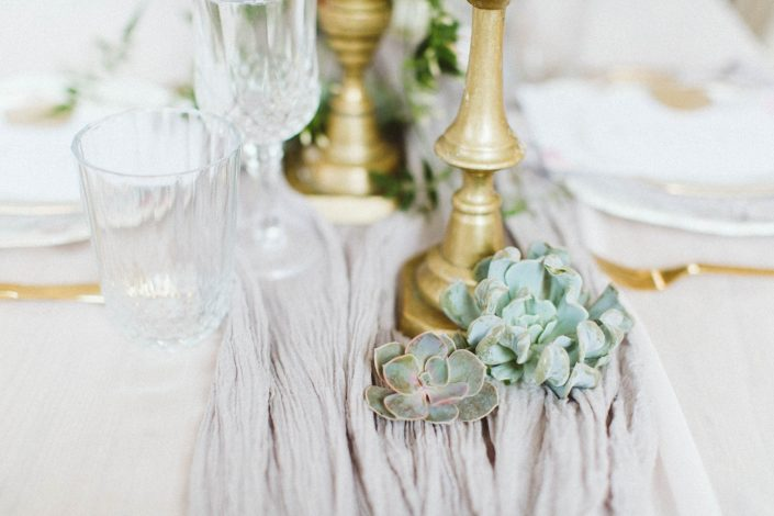 table runner with gold candle holders