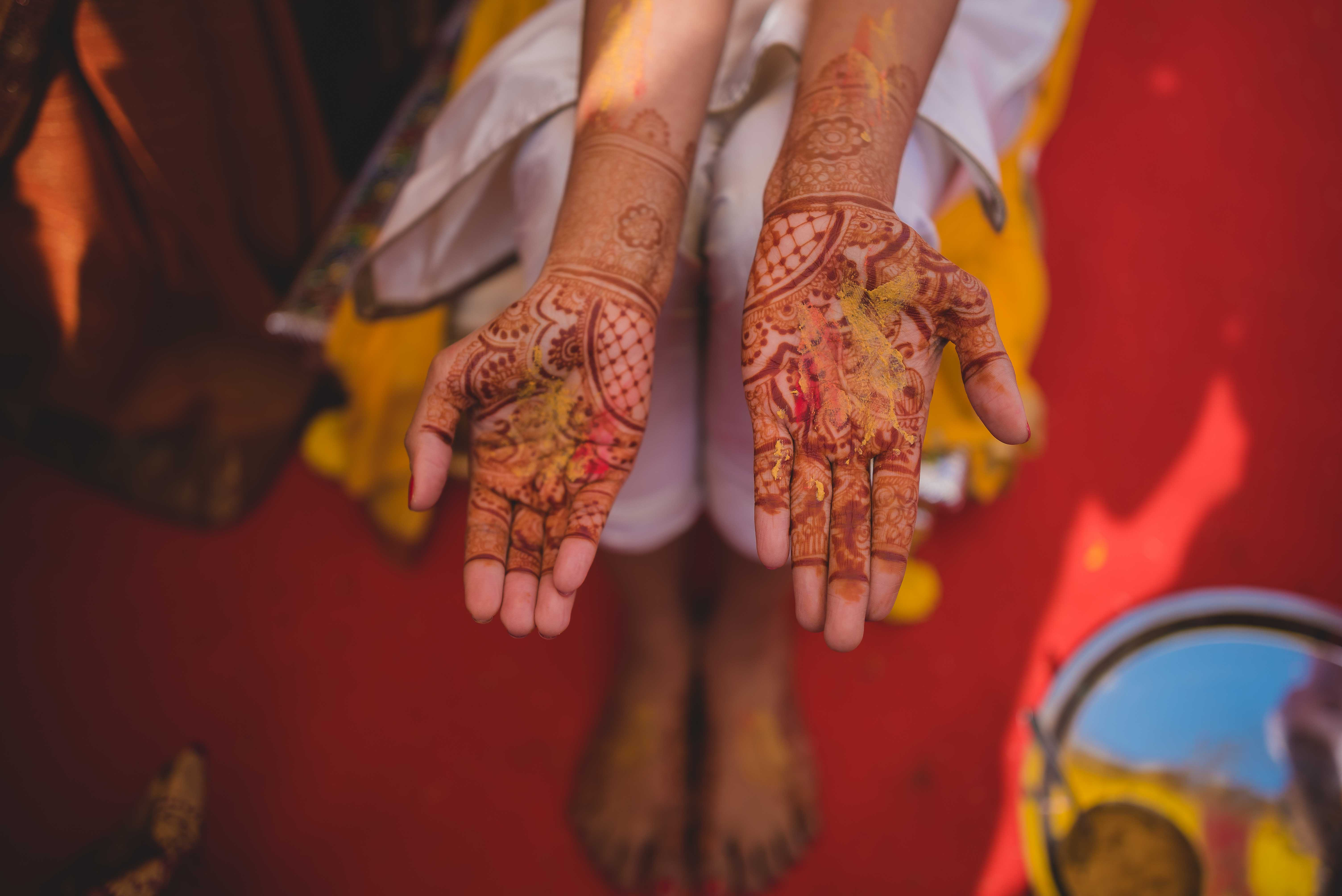 Exotic Destination Wedding in India - Bride Nidhi with mehndi