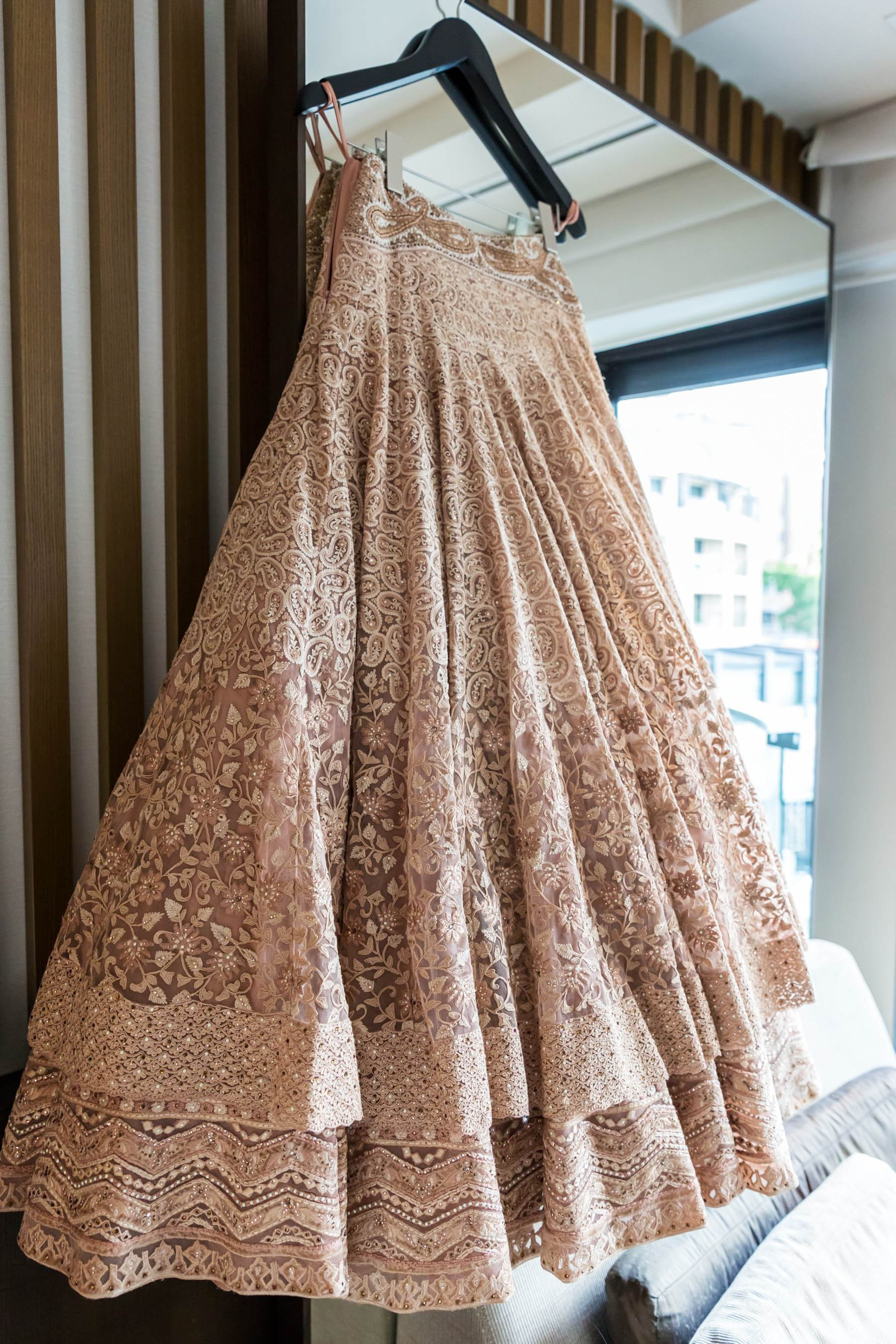For the reception, Myura chose to wear a nude, gold colour, layered lehenga design from wedding lehenga experts, Frontier Raas.