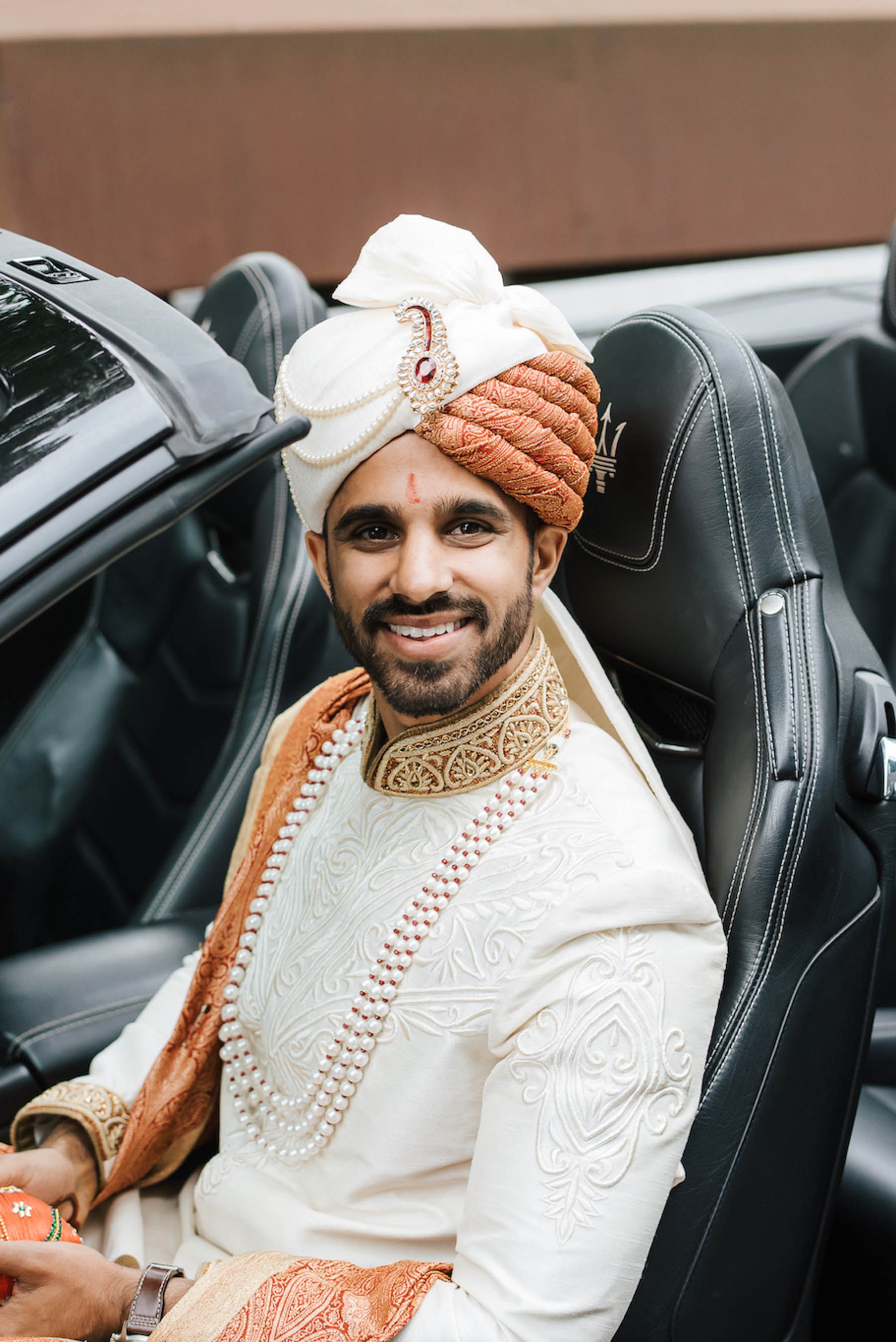 Groom, Cheten's groomswear was purchased from Millionaire in India.