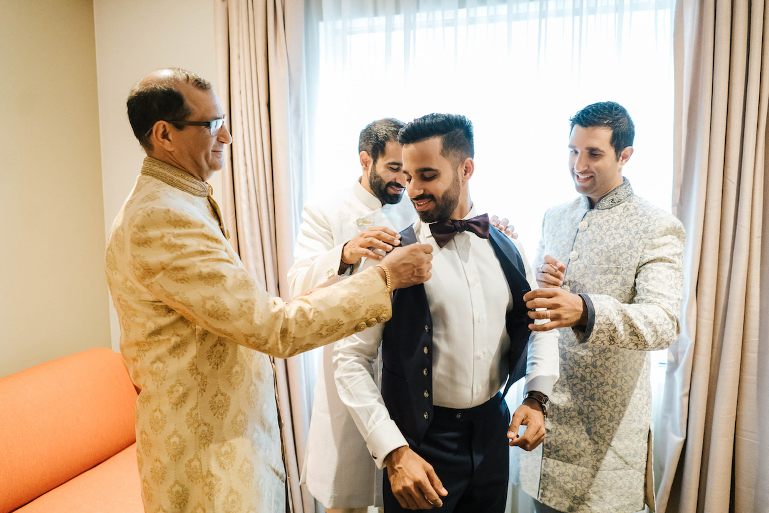 Chetan's wedding reception suit was designed by The Suit Shop. He chose a navy three piece with his initials and our wedding date stitched on the inside of the suit jacket.