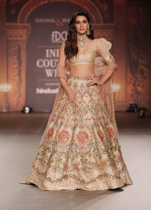 Floral design lehenga by Shyamal And Bhumika at India Couture Week 2019.