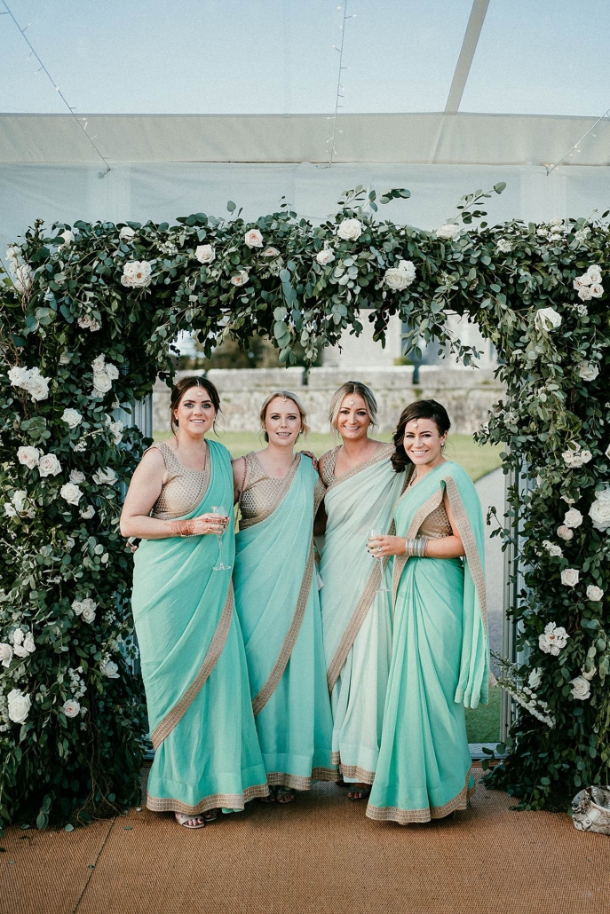 Bride Lindsay's beautiful bridesmaids dressed in sarees designed by Styl By Meha in Delhi.