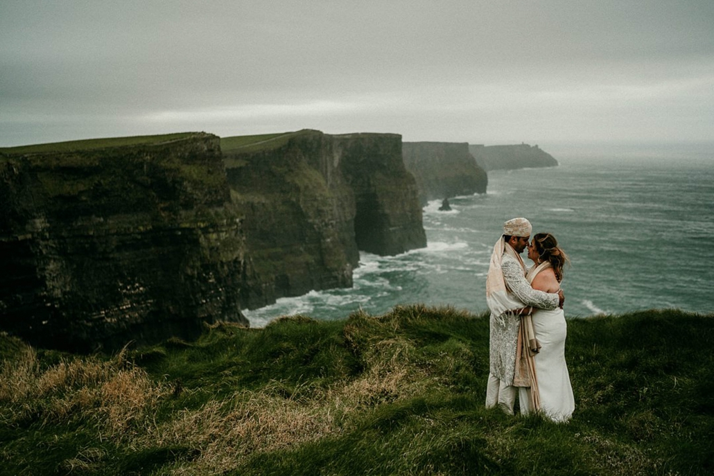 Lindsay and Miten's at the famous Cliffs Of Moher attraction along the Wild Atlantic Way. Beautifully captured by Epic Love Photography.
