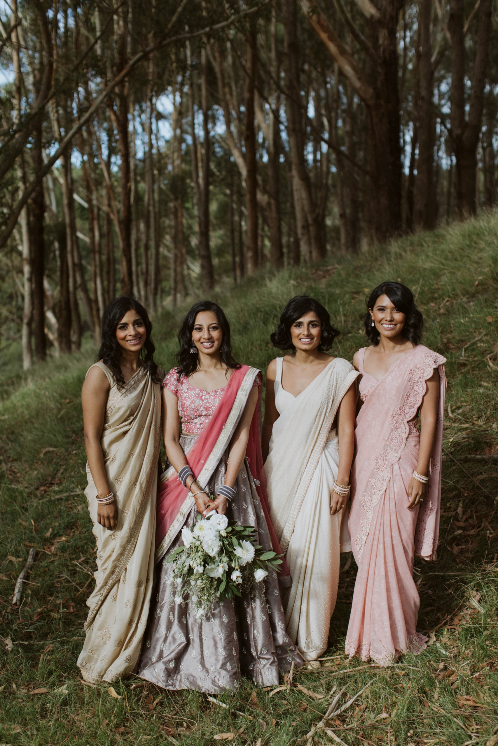 Indian bride, Shilpa with her bridesmaids dressed in beautiful sarees for their wedding reception in Auckland, New Zealand.