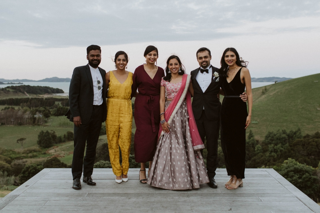 Shilpa and Shakti at their wedding reception in Auckland, New Zealand with bridal party.