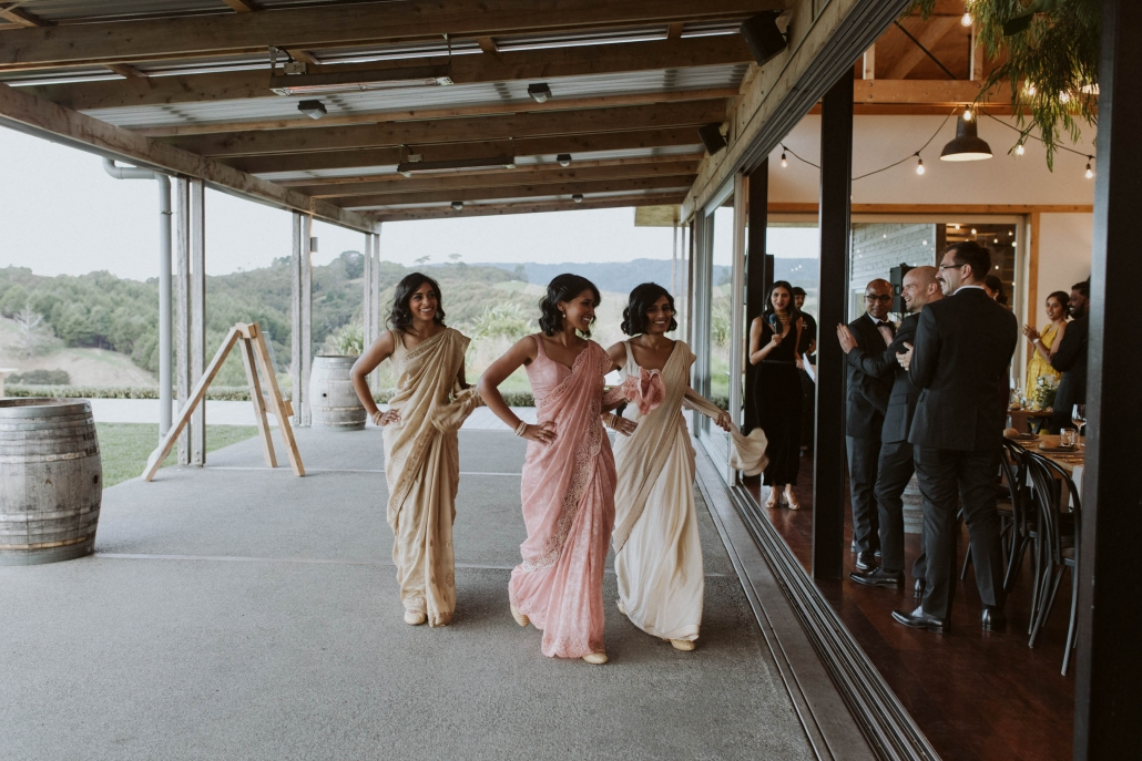 Bride, Shilpa's bridesmaids dressed in sarees for her wedding reception in Auckland, New Zealand.