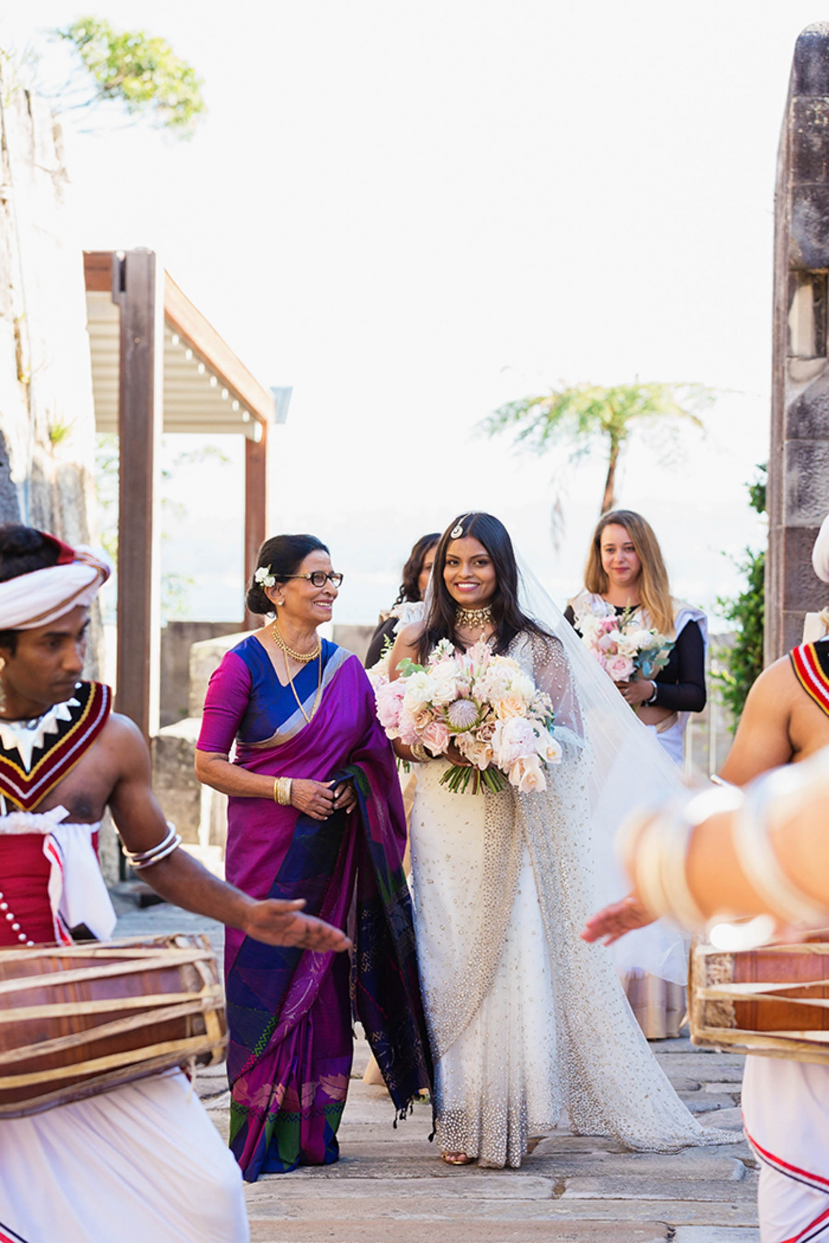 Sri Lankan bride, Erandi walking down the aisle before her Poruwa wedding ceremony in Sydney