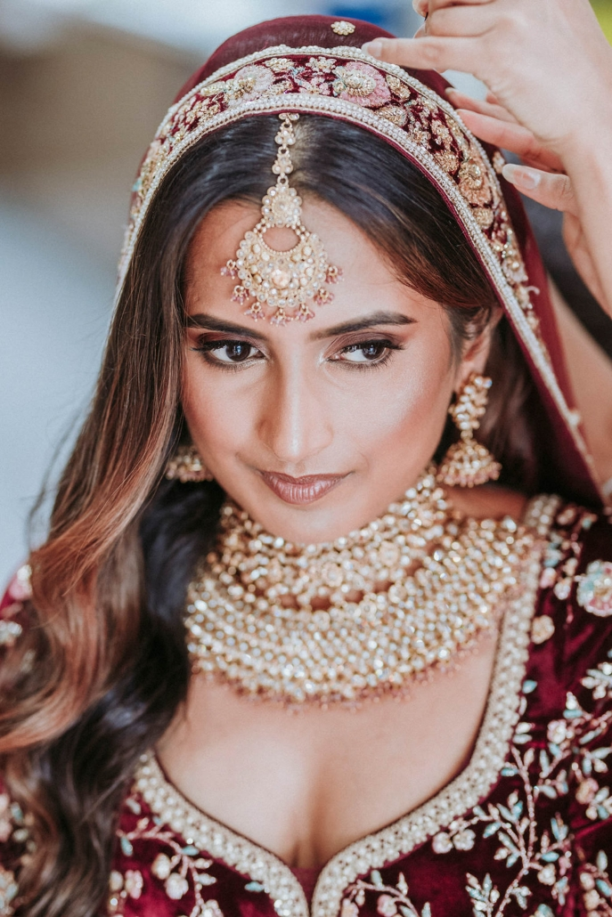 Indian bride, Shaheen chose to wear a classic Sabyasachi lehenga at her cross-cultural wedding in Sydney with hair and makup by Gather and Stitch.