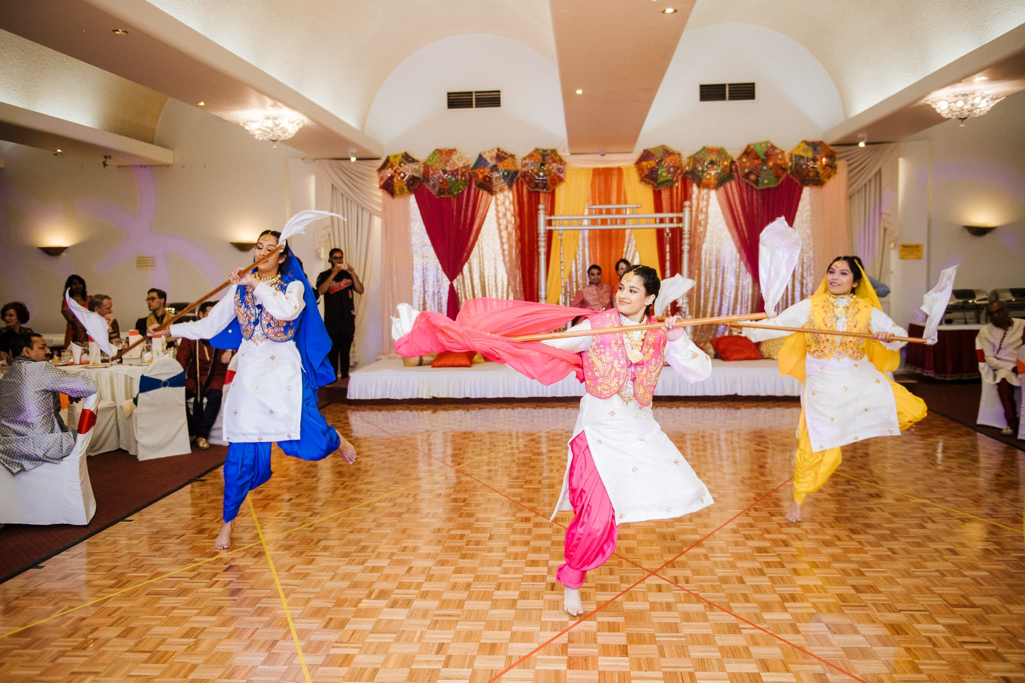 Claire and Rohit's colourful Sangeet party took place at Spirit Of India in Melbourne with Indian wedding decor by Rupali's Mandaps.