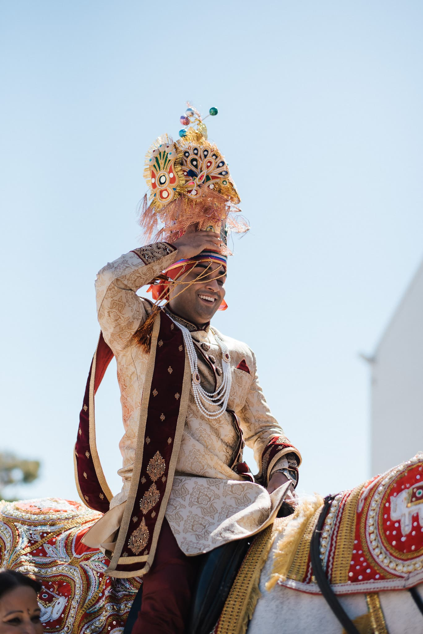 Indian groom, Rohit arriving on a horse for his traditional Indian wedding in Melbourne.