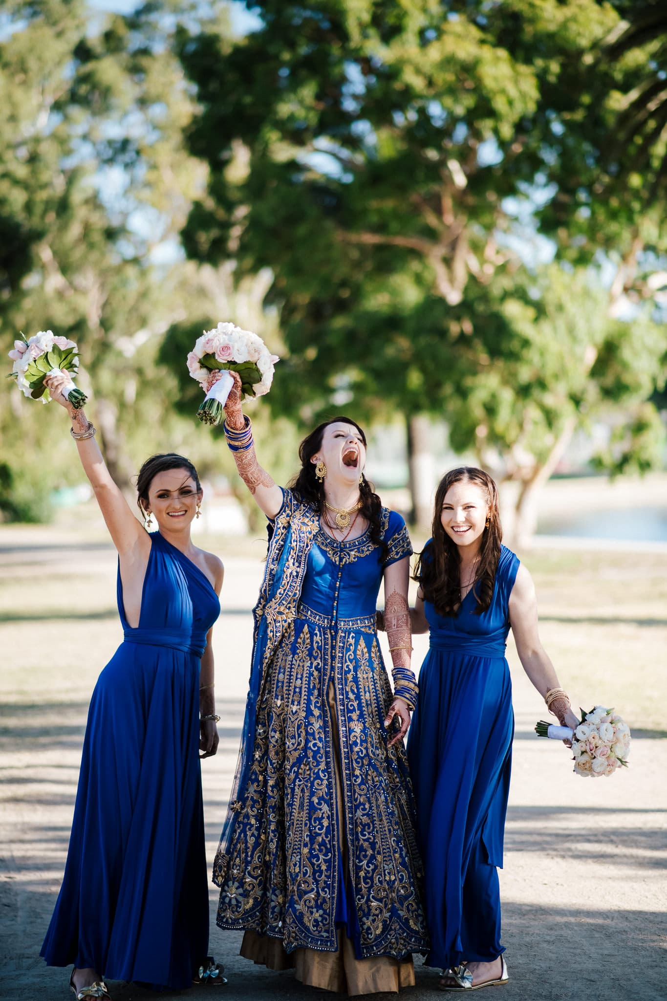 Melbourne bride, Claire with her bridesmaids at her colourful multicultural wedding.