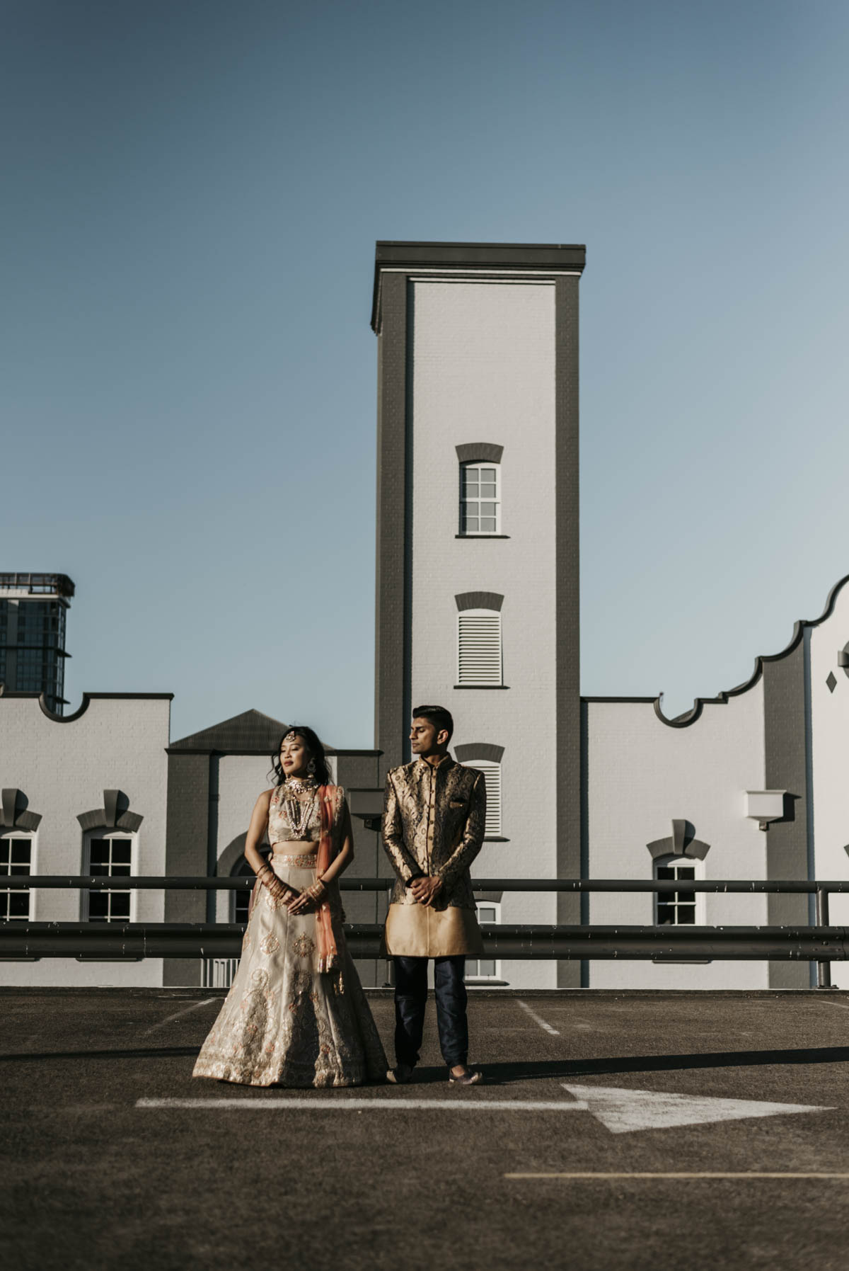 Shay and Uppi's muticultural wedding took place in Brisbane, Australia. They were both dressed in traditional Indian attire for their wedding reception, with Shay dressed in a bridal lehenga and Uppi in a sherwani suit. Photography captured by Sal Singh Photography.
