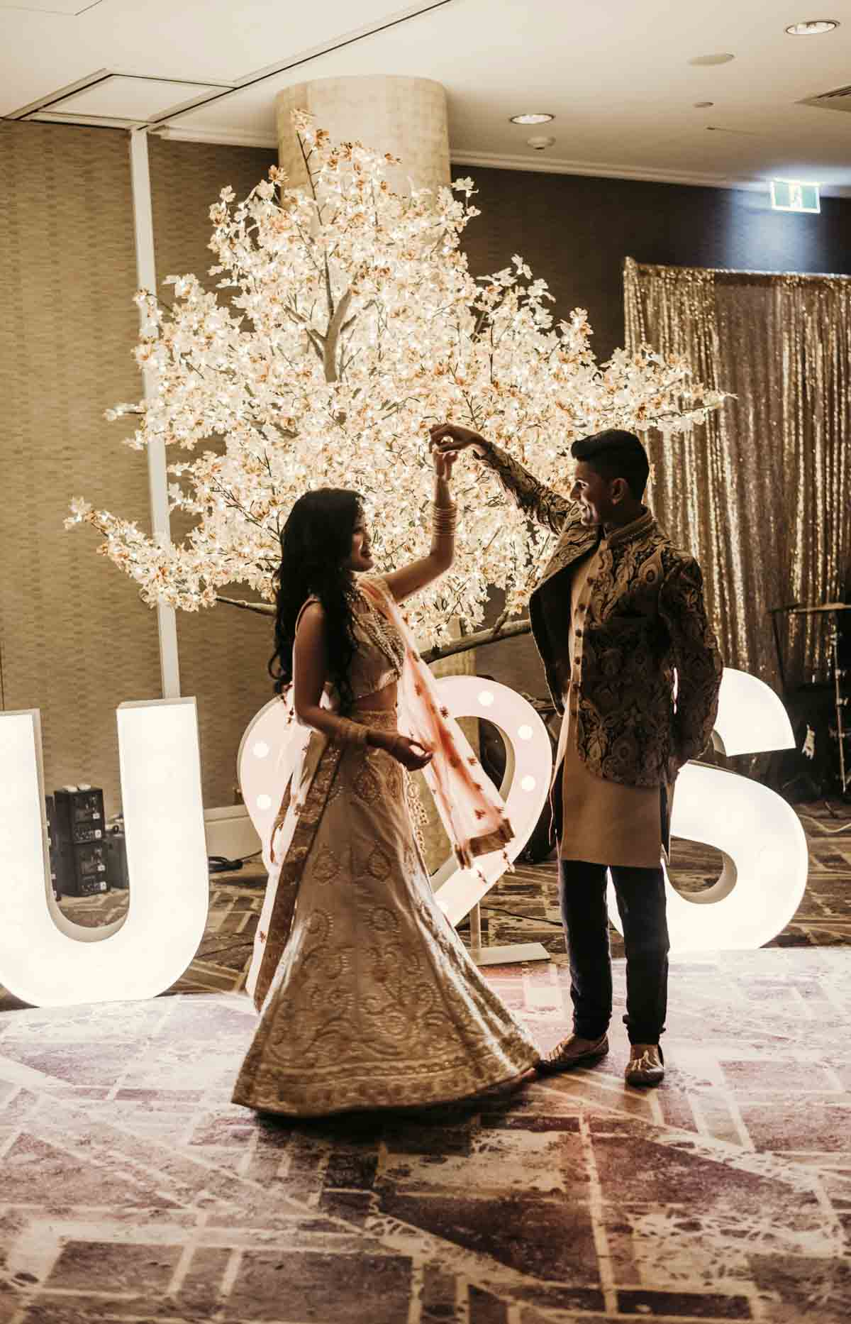 Shay and Uppi's modern and romantic fusion wedding reception party was a grand affair with light up letters, pyrotechnics and even a cheese wedding cake. The reception took place at The Rydges hotel in Brisbane, Australia. Photography captured by Sal Singh Photography.