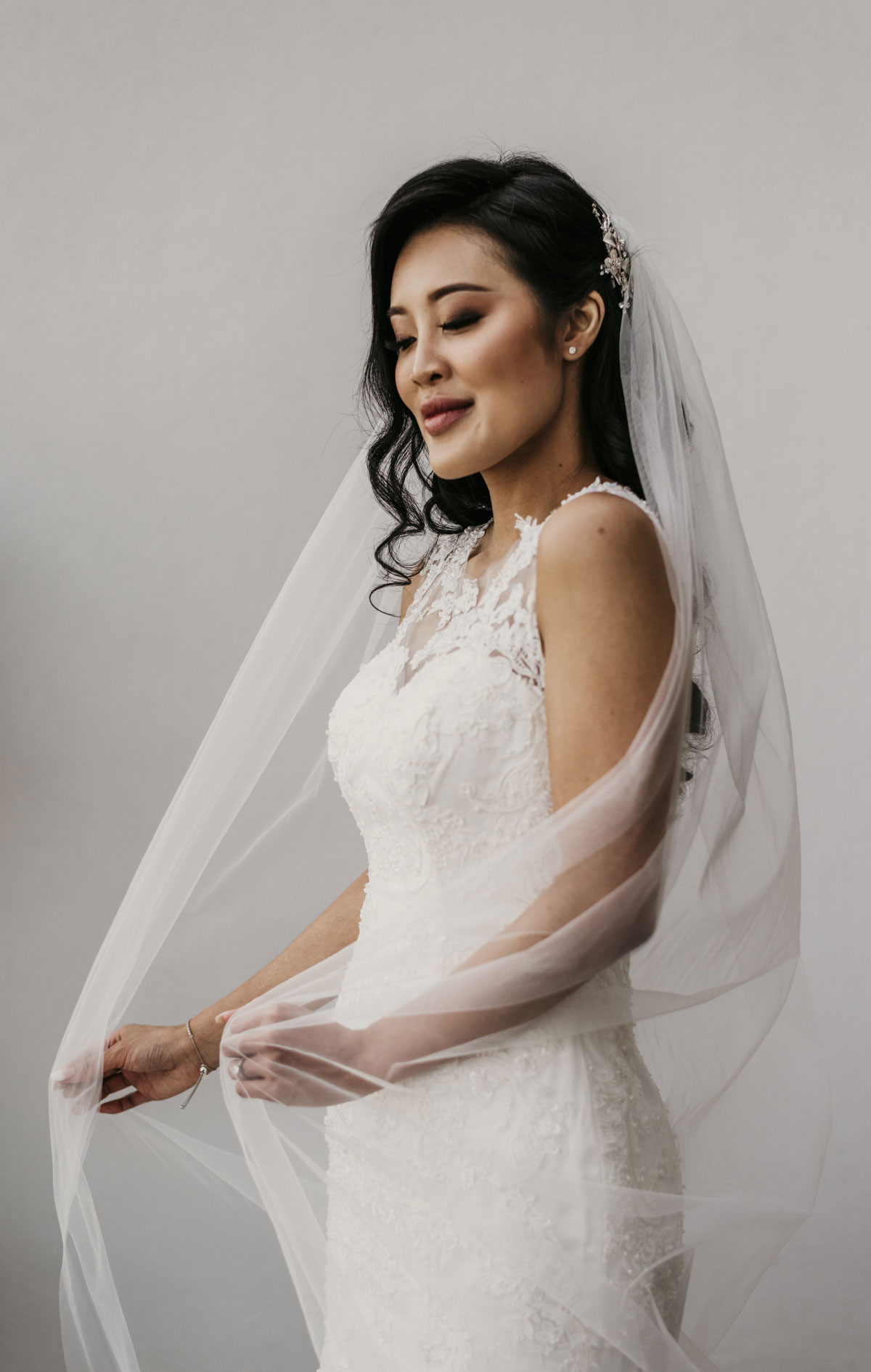Shay's bridal gown was classy, modern and fitted. She opted for the mermaid cut, with a the most ethereal veil.