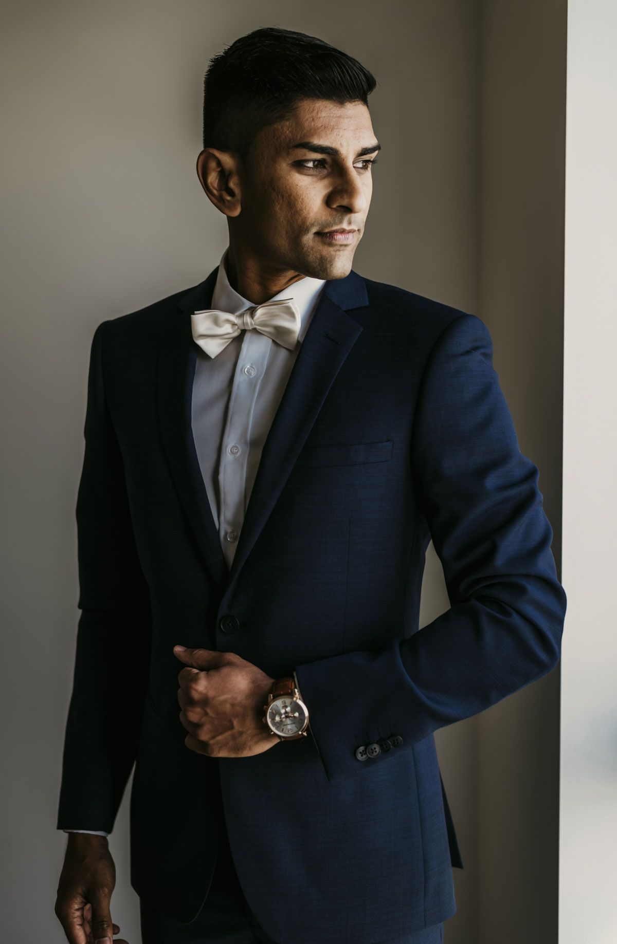 Indian groom Uppi looked dashing in his blue suit at his modern romantic fusion wedding in Brisbane, Australia. Wedding photography was beautifully captured by Sal Singh Photography.