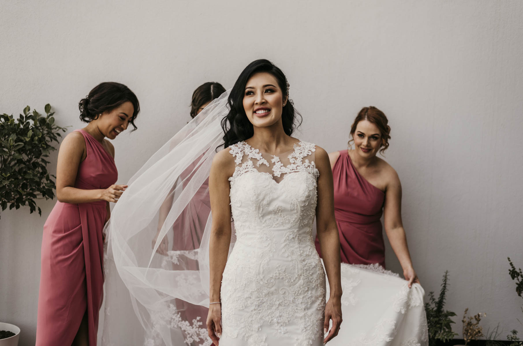Brisbane bride, Shay looked incredible on her wedding day. Dressed in a mermaid cut, white wedding gown. She had the support of her bridesmaids, who helped her get dressed