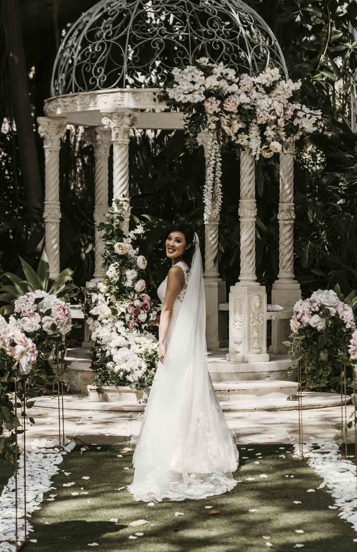 Brisbane bride, Shay looked ethereal in her white wedding gown. The outdoor garden wedding ceremony took place at Boulevard Gardens in Indooroopilly, Queensland.