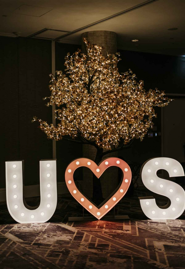 Shay and Uppi's modern and romantic fusion wedding and reception took place in Brisbane. Their wedding reception included these amazing light up letters.