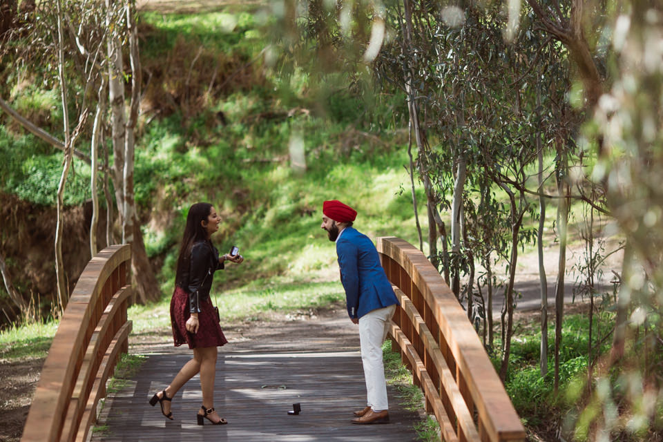 Melbourne couple Anmol and Simran's surprise wedding proposal actually caught the both of them off guard. Both of them proposed to one another. Photography was captured by Bhargav Boppa Photography.