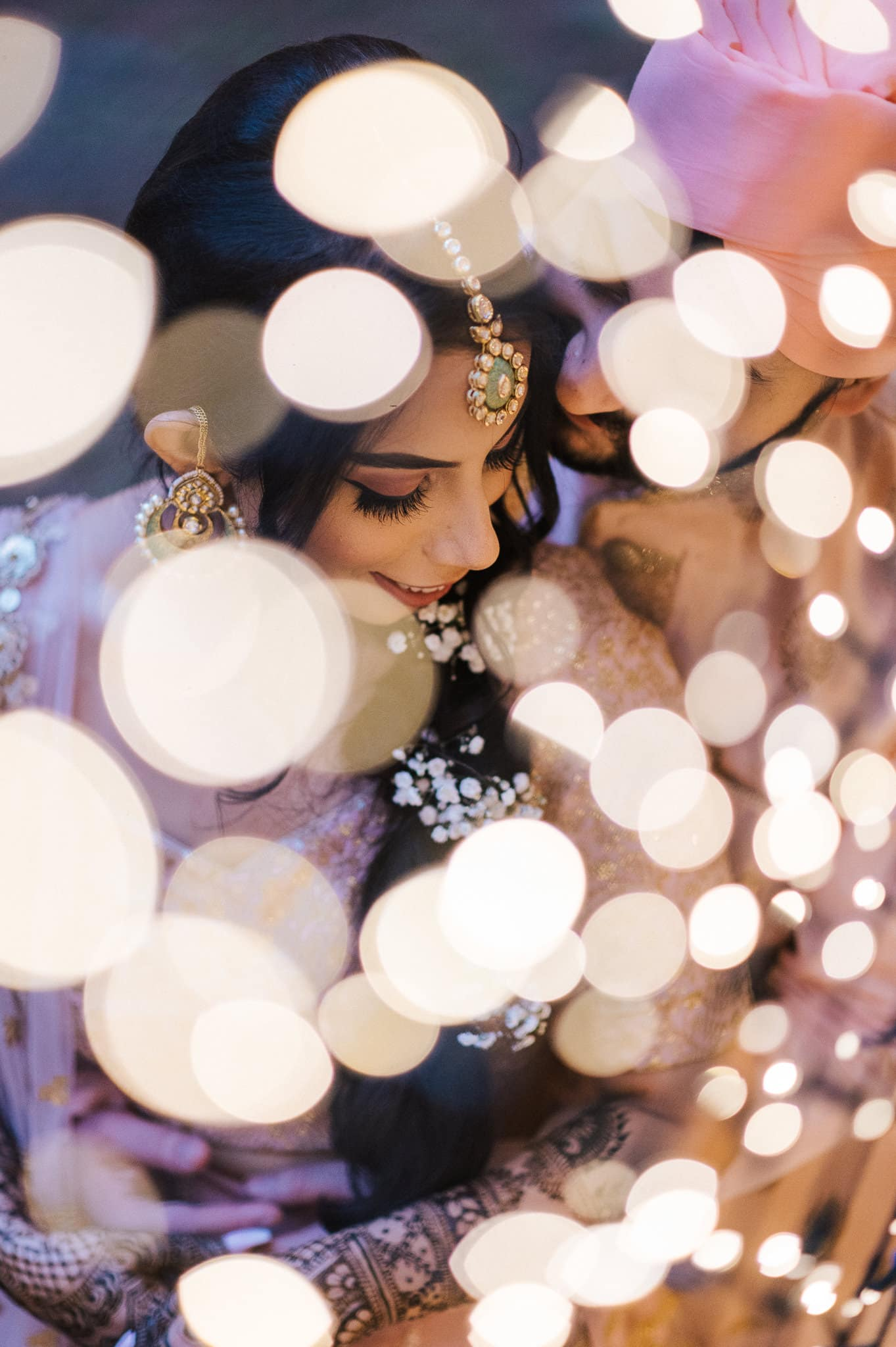 Simran and Anmol's vibrant and modern wedding began with the Mehndi and Sangeet party in Melbourne, Australia. Wedding Photography was captured by Indian wedding photographer, Bhargav Boppa. Both bride and groom were dressed in matching bridal lehenga and sherwani suits for every function.