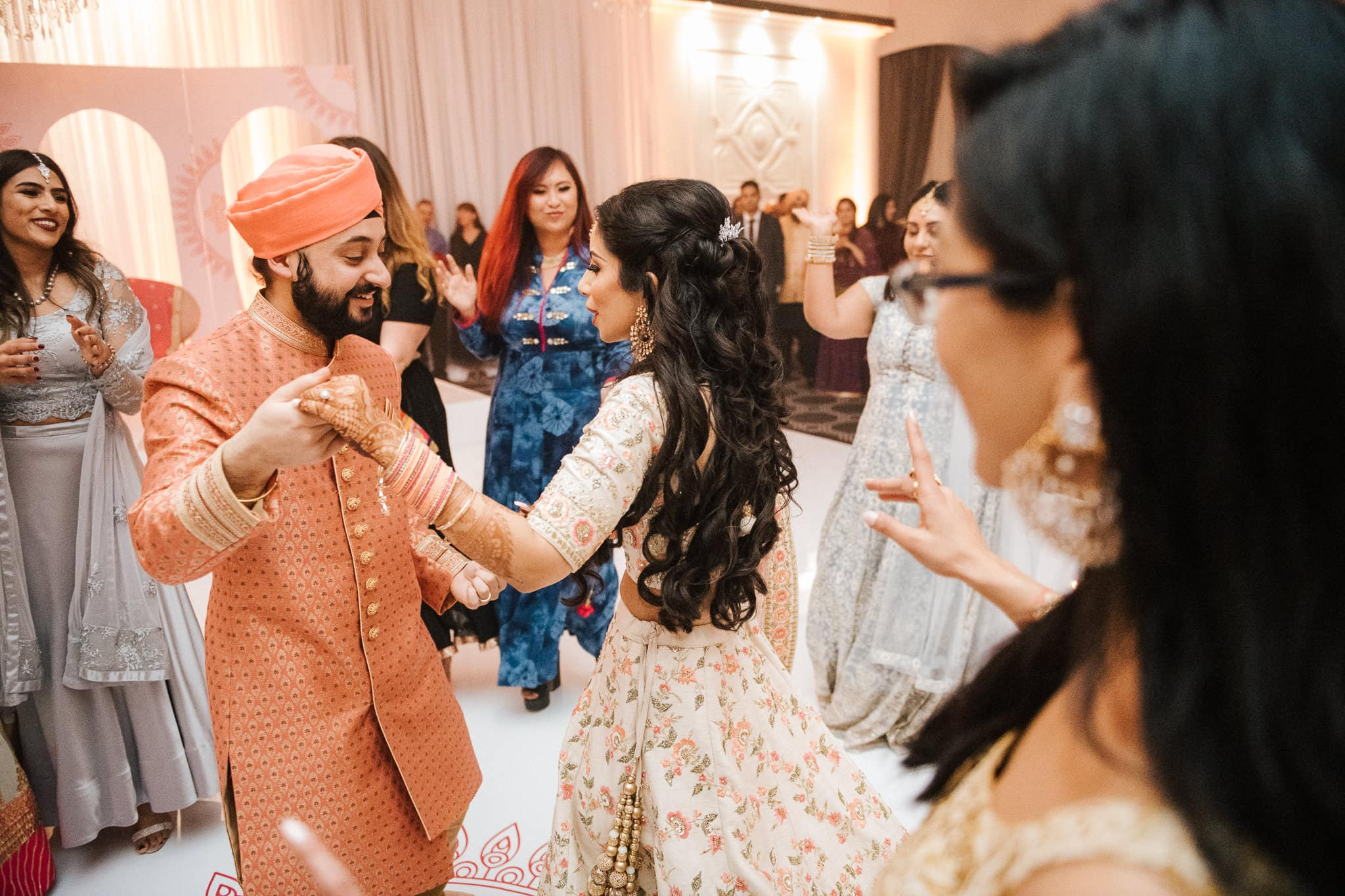 Simran and Anmol's vibrant and modern Sikh wedding celebration began with their Sangeet party in Melbourne. The function was held at the Vogue Ballroom with wedding photography captured by Indian wedding photographer, Bhargav Boppa. Simran danced all night long with her bridal party on the wedding dancefloor.