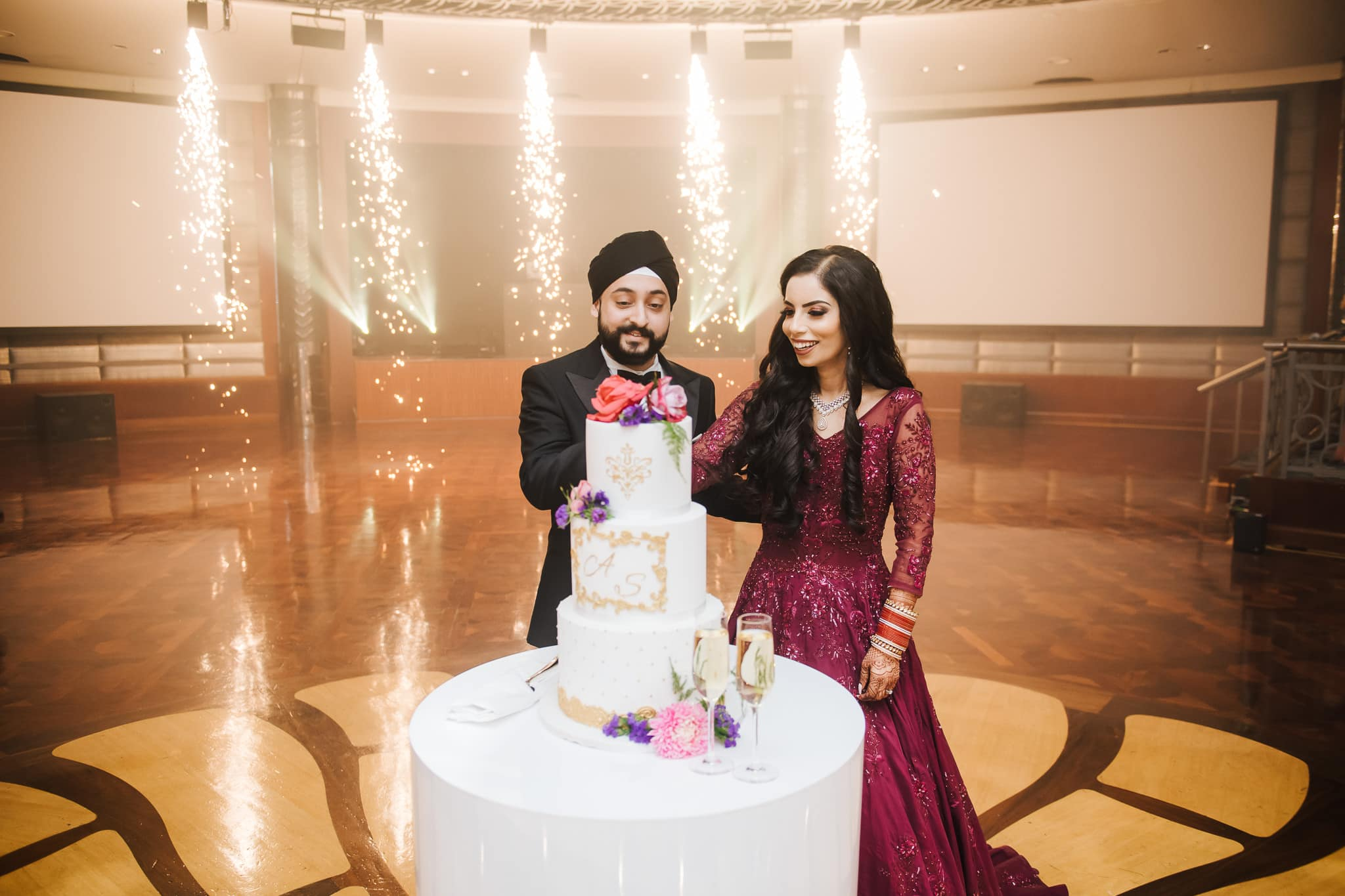 Simran and Anmol's vibrant Sikh wedding celebration in Melbourne came to a close with an opulent wedding reception party held at Park Hyatt, Melbourne. Groom Anmol, was completely in his element, with impressive LED screens, pyrotechnics plus more.