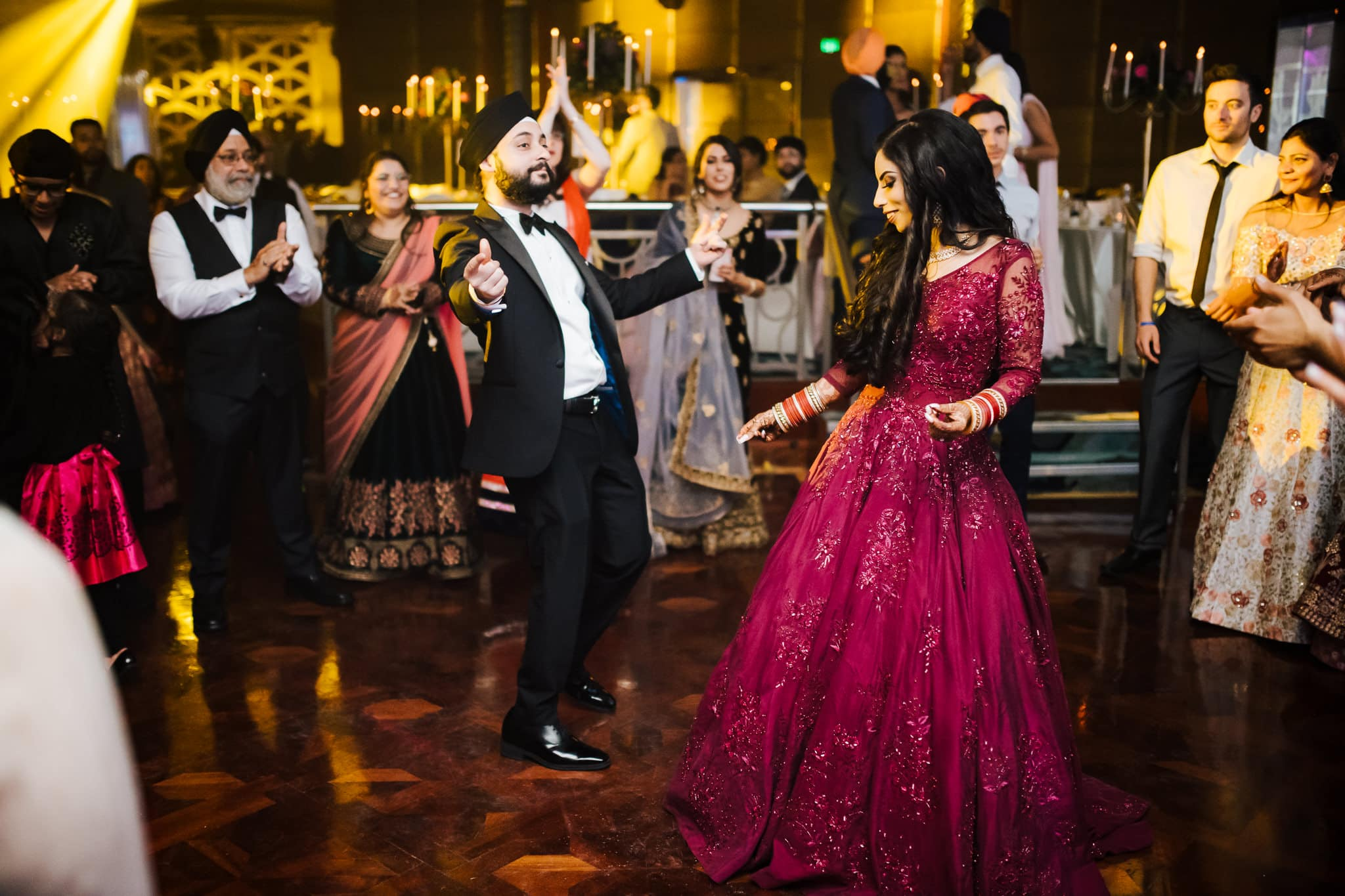 Melbourne couple, Simran and Anmol dancing at their wedding reception party at Park Hyatt Melbourne. Check out their beautiful and modern Sikh wedding celebration only on The Maharani Diaries.