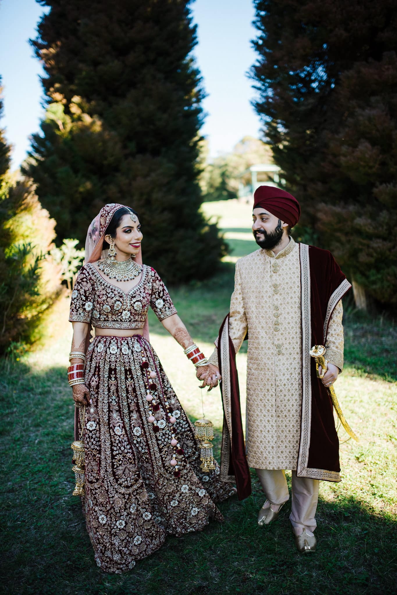 Simran and Anmol's vibrant and modern Sikh wedding celebration in Melbourne. Wedding photography was captured by Indian wedding photographer, Bhargav Boppa. The couple were colour coordinated for every function. We loved Simran's royal and elegant bridal lehenga for her wedding day especially.