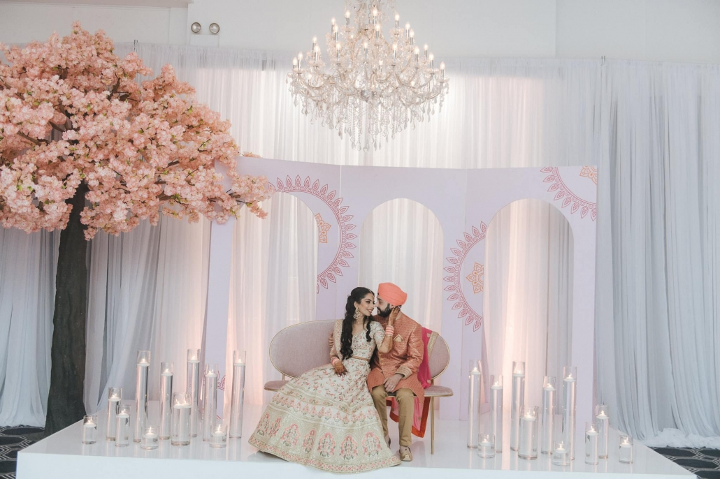 Melbourne bride and groom, Simran and Anmol at their sangeet party at Vogue Ballroom. Their sangeet party was styled by Kerr Events. Go behind the scenes of their Sikh wedding celebration only on The Maharani Diaries. Photography by Bhargav Boppa.