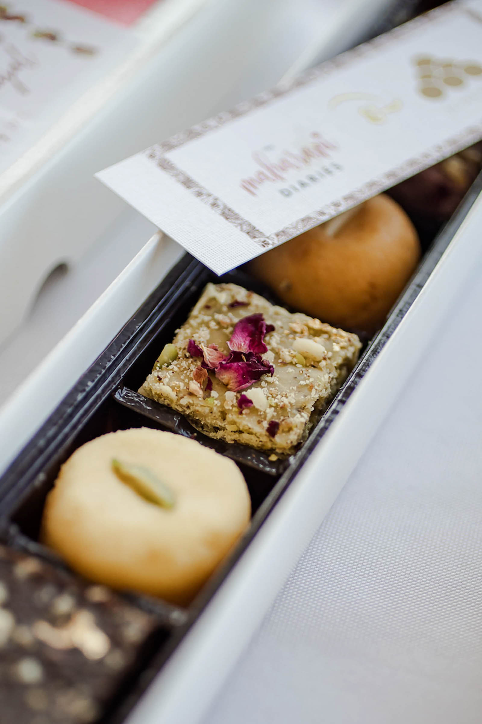 Indian sweets presented in a wedding favour box
