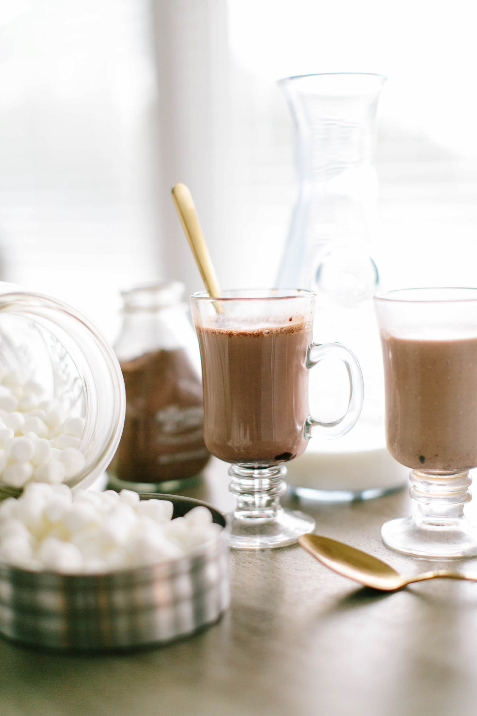 Glasses served with hot chocolate with marshmallows on the side